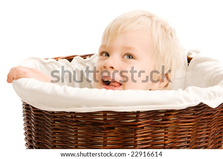 Portrait of beautiful young child in a wicker basket