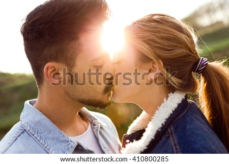 Portrait of beautiful young couple in love in the park. - stock photo