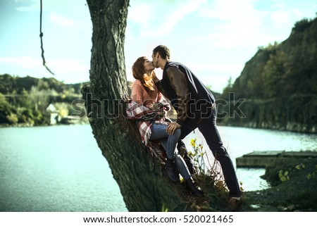 Portrait of Beautiful Young Couple in Love on nature.