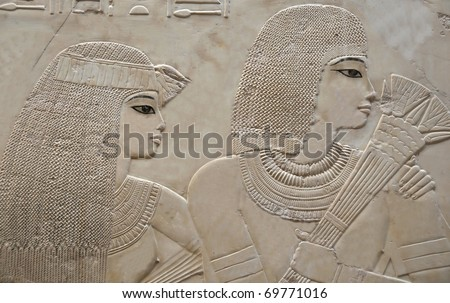 Portrait of beautiful young couple in the Tomb of Ramose in the ancient egyptian necropolis of the nobles at thebes near Luxor, Egypt - stock photo