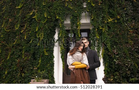 Portrait of beautiful young couple outside. Couple in love outdoor