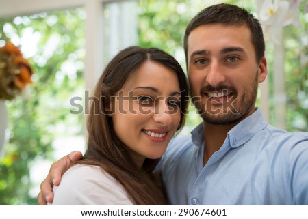 Portrait of beautiful young couple smiling and looking at the camera