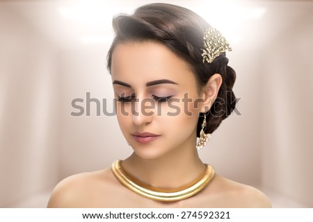 Portrait of beautiful young elegant woman,girl, lady,actress,Greek,Aphrodite, goddess, bride, model, wealth, luxury interior. Perfect nude makeup, beautiful face,soft skin, natural lip, beige, gloss.  - stock photo