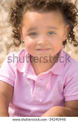 Portrait of beautiful young ethnic girl wearing a pink shirt.