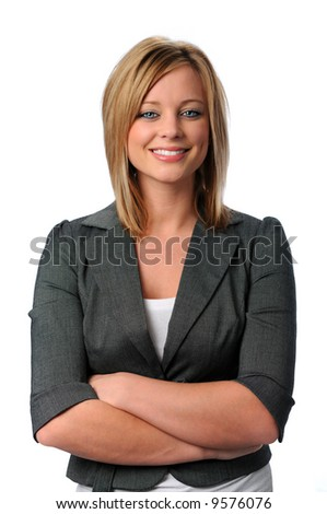 Portrait of beautiful young executive with arms folded and smiling