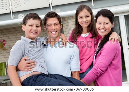 Portrait of beautiful young family having fun outdoors - stock photo