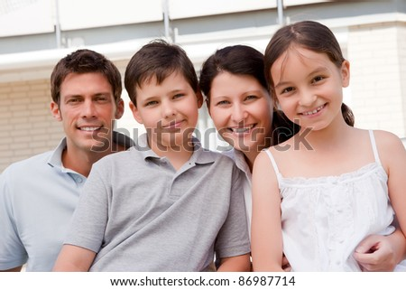 Portrait of beautiful young family together - Outdoor - stock photo