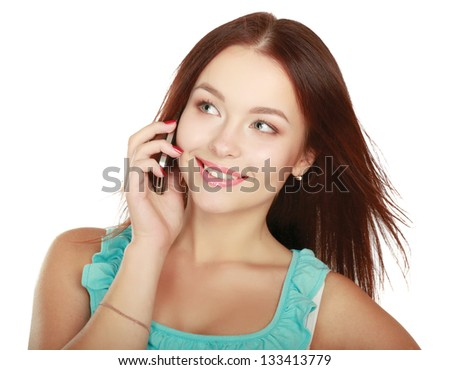 Portrait of beautiful young female using cellphone, isolated on white background - stock photo