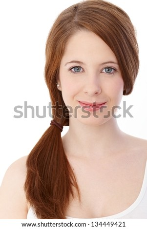 Portrait of beautiful young ginger-haired woman, smiling. - stock photo