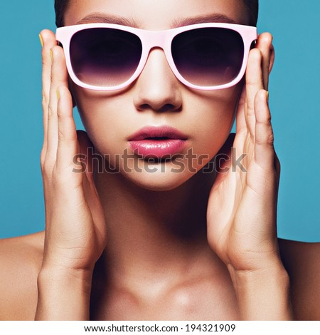 Portrait of beautiful young girl in sunglasses, close up - stock photo