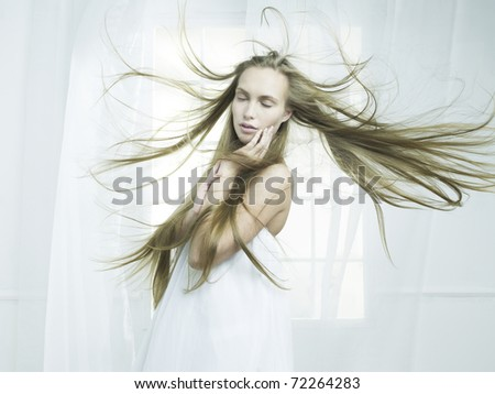 Portrait of beautiful young girl in the interior of the window - stock photo