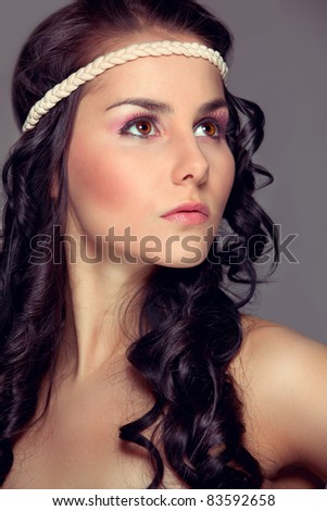 Portrait of beautiful young girl looking in corner. Retouched