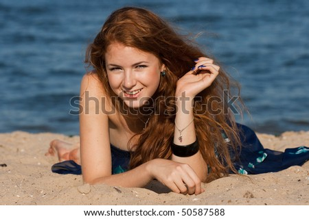 portrait of beautiful young girl on beach - stock photo