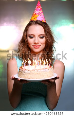 Portrait of beautiful young girl on bright background - stock photo