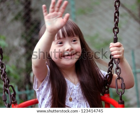 Portrait of beautiful young girl on the playground - stock photo