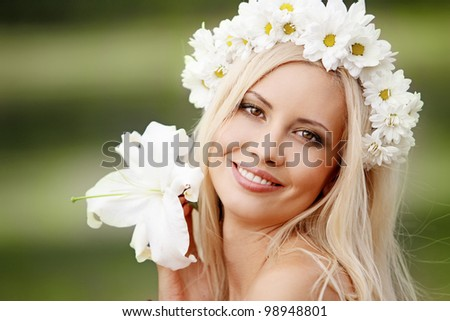 Portrait of beautiful young girl outdoors in spring - stock photo