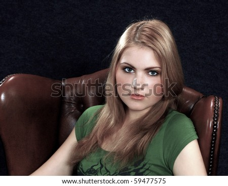 portrait of beautiful young girl sitting on chair