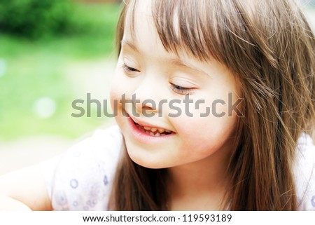 Portrait of beautiful young girl smiling in the park - stock photo