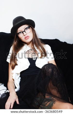 Portrait of beautiful young girl wearing hat and eyeglasses