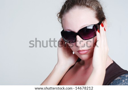 Portrait of beautiful young girl with antisun glasses on a white background