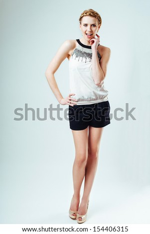 Portrait of beautiful young girl with braid hairstyle. Fashion concept. - stock photo