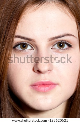 Portrait of beautiful young girl with clean skin and beautiful face