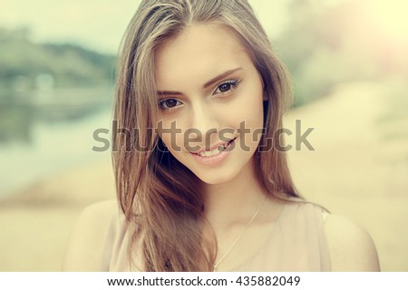 Portrait of beautiful young girl with clean skin and pretty face