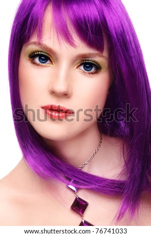 Portrait of beautiful young girl with fancy bright make-up and violet wig, on white background - stock photo
