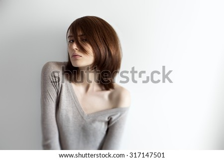 Portrait of beautiful young girl with naked shoulder - stock photo