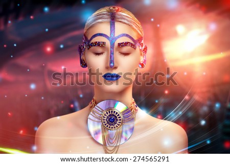 Portrait of beautiful young girl, woman, lady, model alien. Universe planet technology, space. Bright creative makeup, blue lips, ears, multicolored rhinestones, eyebrows. Stylish decoration, robotic  - stock photo
