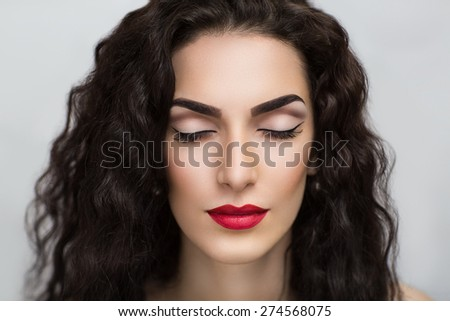 Portrait of beautiful young girl, woman, lady, model. Flawless makeup, perfect shape of the eyebrows, long eyelashes, bright red lipstick. Image can be used for advertising of new cosmetic products - stock photo