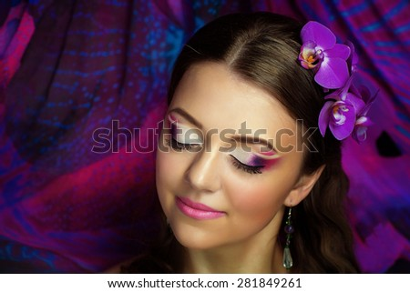 Portrait of beautiful young girl, woman, model, sorceress, fairytale, magic, illusion. Perfect, creative makeup, light skin, bright, expressive eyes, pink lips, charming smile. Chic fashion art look.  - stock photo