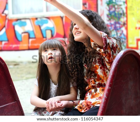 Portrait of beautiful young girls on the playground.