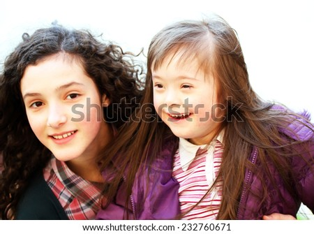 Portrait of beautiful young girls smiling - stock photo