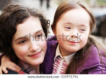 Portrait of beautiful young girls together - stock photo