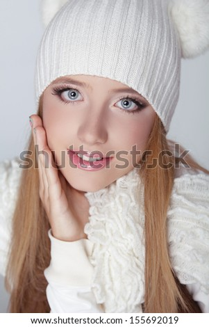 Portrait of beautiful young happy girl wearing winter clothing studio shot. Winter time - stock photo