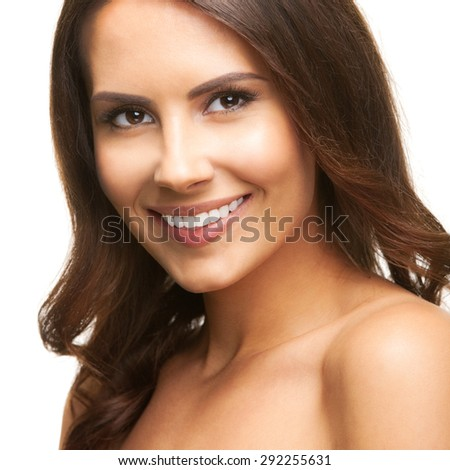 Portrait of beautiful young happy smiling brunette woman, looking at camera, isolated against white background. Beauty and fashion concept studio shoot.