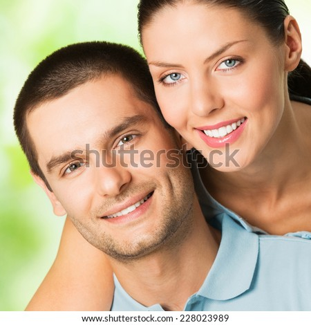 Portrait of beautiful young happy smiling carefree couple, outdoor