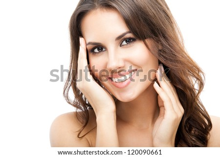 Portrait of beautiful young happy smiling woman with long curly hair, isolated over white background