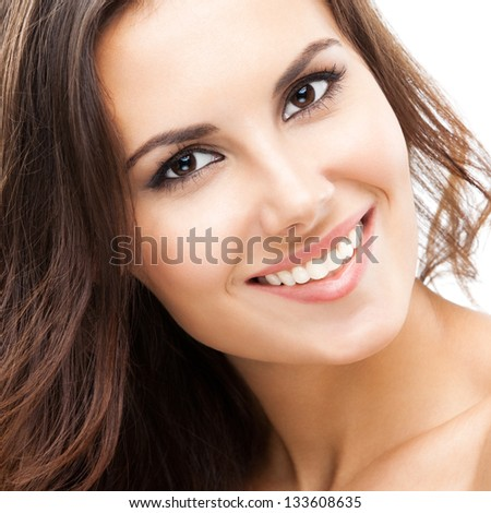 Portrait of beautiful young happy smiling woman with long hair, isolated over white background