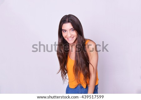 Portrait of beautiful young hispanic / caucasian woman, isolated over grey background. - stock photo