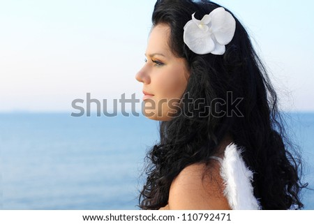 Portrait of beautiful young lady looking away - stock photo