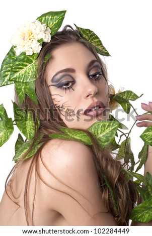 Portrait of beautiful young lady with flower and leaf  in her hair over white - stock photo
