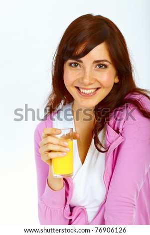 Portrait of beautiful young lady with glass of orange juice - stock photo