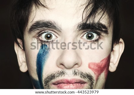 Portrait of beautiful young man with paint on face