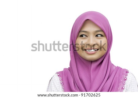 portrait of beautiful young Muslim Woman looking to the copyspace - isolated over a white background - stock photo