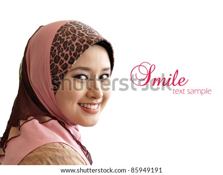 portrait of beautiful young Muslim woman was glanced into the camera with sweet smile on a white background - stock photo