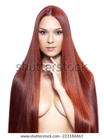 Portrait of beautiful young nude woman with long red hair isolated on white background