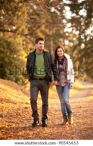 portrait of beautiful young pair in a park - stock photo