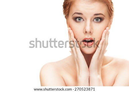 Portrait of beautiful young redhead woman with clean face. High key shot. - stock photo